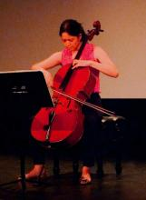 "performing ""Soliloquy for solo cello"" by Elizabeth Bell"